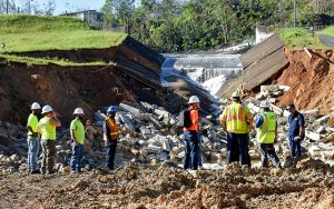 Spillway completely damaged. Thompson's staff 1st day on the job evaluating the upcoming project.