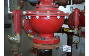 Image shows the DFT model FBC Compact Check Valve installed on the down-stream side of the Vertical Dump Valve