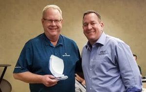 Loran Knudsvig (left) accepts award from Adam Stolberg (right), Executive Director of SWPA (Submersible Wastewater Pump Association)