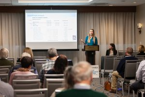 Alexandra Rozen (at podium) and Chelsea Conlon, Engineers with JKMuir, give a presentation at the New England Water Environment Association meeting in January.