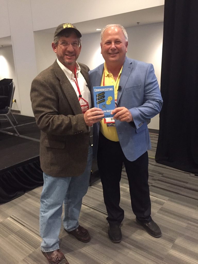 Bob Latino with JD Solomon, with Jacobs Engineering, presenting his new book
